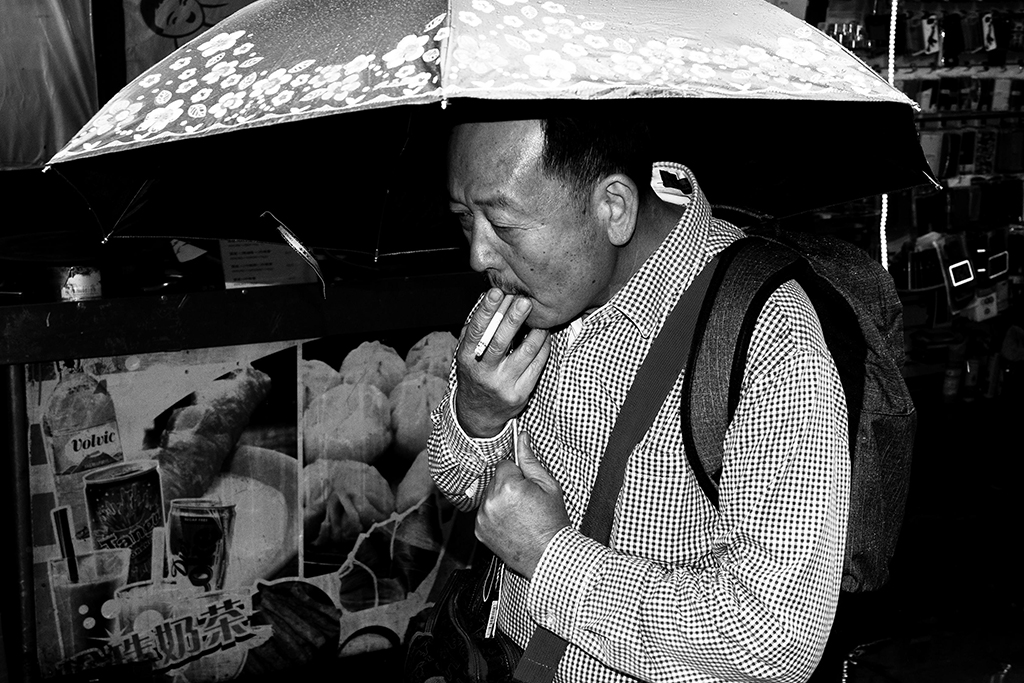 UMBRELLA SMOKER. China Town, London 2015